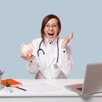 Nurse holding piggy bank with bigger salary